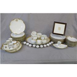Large selection of hand painted and initialled gold and white Bavarian china including cups and sauc
