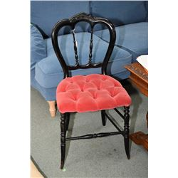 Delicate side chair with button tufted seat