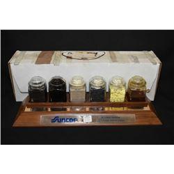 Desk top Suncor Oil Sands Division, Fort MacMurray presentation piece of oil samples, purportedly gi