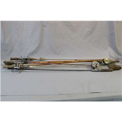 Seven vintage fishing rods including split cane, metal etc., some with reels including Good-All etc.