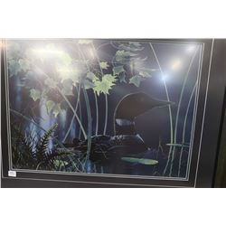 Framed limited print of a loons signed by artist Rod Tribiger 7/950
