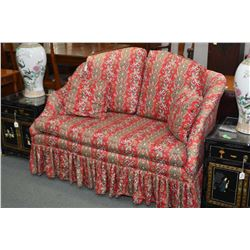 Cotton upholstered loveseat with matching pillows and two accent pillows