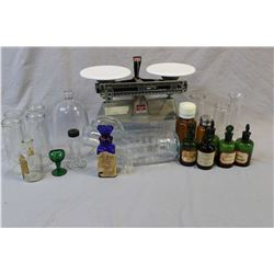 Selection of vintage medical and apothecary bottles, glass eye washes etc. and an O'Haus Harvard Tri