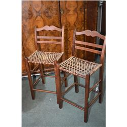 Pair of ladder back bar stools with woven hide seats