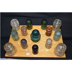 Selection of vintage glass ceramic insulators on handmade display board