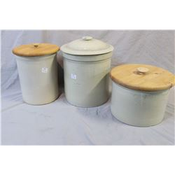 Three stoneware crocks including 2 gallon Medalta with distressed lid, an unmarked stoneware crock w