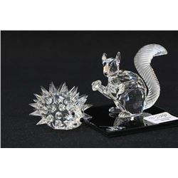 """Two Swarovski crystal figurines including 10th Anniversary edition The Squirrel 2"""" in height with si"""