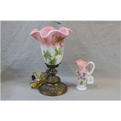 Two pieces of hand-painted Fenton glass including a limited edition handled pitcher and a table lamp
