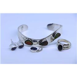 Sterling silver and ammonite cuff bracelet, a pair of sterling and synthetic sapphire earrings and m