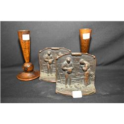 Pair of heavy cast bookend featuring a rural scene with a man and a women praying and a pair of turn