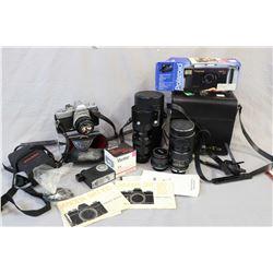 Selection of camera gear including Vivitar 58mm telescoping lens, a Optron macro lens, a Dimension 1
