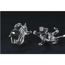 """Two Swarovski crystal figures including 2"""" tall elephant and a lion cub, both with original boxes"""