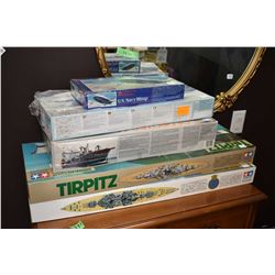 Five new in box plastic model kits including battleships, submarine and blimp
