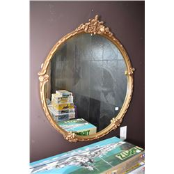 Round gilt framed bevelled mirror