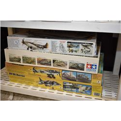 Four unassembled plastic model military kits including three airplanes and a Centurial Mk.III tank