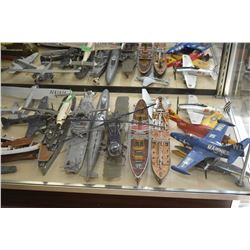 Large selection of assembled plastic mostly military models including planes, helicoptors, boats, et