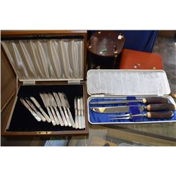 Three pieced boxed stag handled carving set and a twelve piece knife set with mother of pearl handle