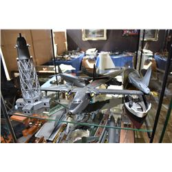 Large selection of assembled model kits including aeroplanes, ships, buildings, etc