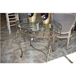 Designer wrought iron table with glass top