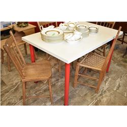 Modern arborite table with red painted legs and four mismatched vintage chairs