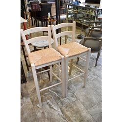 Two modern breakfast / bar stools with backs and rush seats