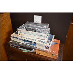 Five unassembled civilian aircraft plastic model kits including Royal Canadian Air Force Douglas C-4