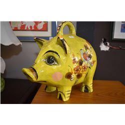 Decorative papier mache pig and a figural lamp planter of a man riding an elephant