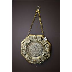 Interesting figural cast wall clock with quartz movement working at time of cataloguing