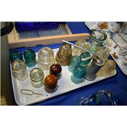 Wood and glass washboard, two sadirons and two glass jars, selection of glass and ceramic insulators