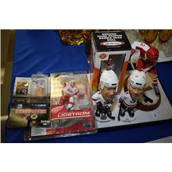 Six sports figurines including three bobble heads , etc