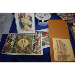 Folios containing unframed prints of content like Russian folktales, Tales by Pushkin and a framed F