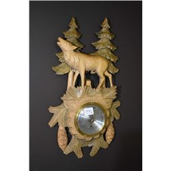 Corona Artware wall hanging of a nude female figure and a black forest style barometer