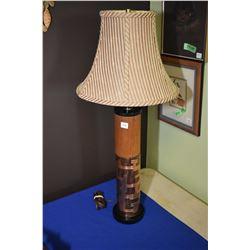 Modern columnar table lamp in geometric copper design signed by designer