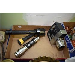 Three flashlights and a vintage Bell & Howel Zoomatic Directors Series movie camera, brass candlesti