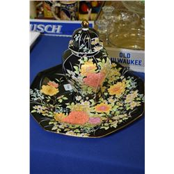 Black and floral charger and a matching ginger jar