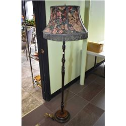 Turned wooden floor lamp with fringed shade