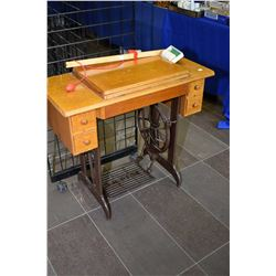 Singer treadle sewing machine in oak and metal cabinet with accessories
