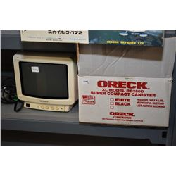 """Small Sony Trinitron 10"""" colour TV with remote and accessories and an Oreck XL Model BB280D super co"""