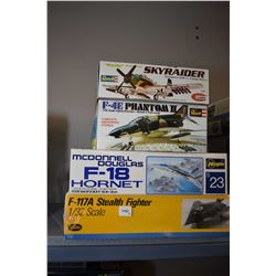 Four unassembled plastic model plane kits including F-117A Stealth Fighter, McDonell Douglas F-18 Ho