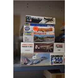 Five unassembled plastic model aircraft kits including Grumman F-14A Tomcat, Rommel's Storch Fiesele
