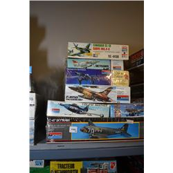 Seven unassembled plastic aircraft model kits including C-47 Skytrain, F9F Panther, P-39 Airacobra,