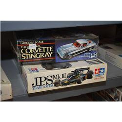 Two unassembled model kits including Team Lotus J.P.S Mk. III race car and Corvette Stingray