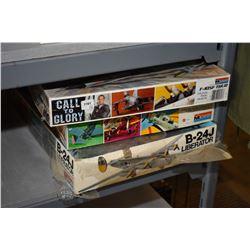 Six unassembled plastic model kits including B-24J Liberator, F-105F Thud, Devastator TBD-I, Thunder