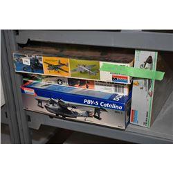 Seven unassembled plastic model kits including PBY-5 Catalina, F-102 Delta Dagger, B-25 Mitchell, F-