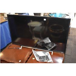 Sony flat screen television model no. KDL-40W600B with selection of remote controls