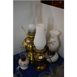 Two oil lamp motif electric lamps and two oil lamps, one converted to electric