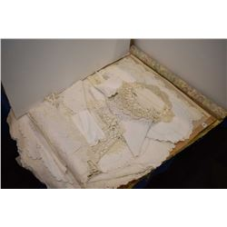 Large selection of linens including cut work doilies, tablecloths, placemats etc.