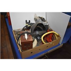Selection of tools and workshop items including bottle jacks, grinding mask, polishing stone, assort