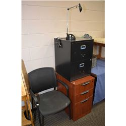 Two filing cabinets, small desk lamp and an office chair
