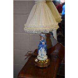 Pair of porcelain bedside lamps, one male, one female